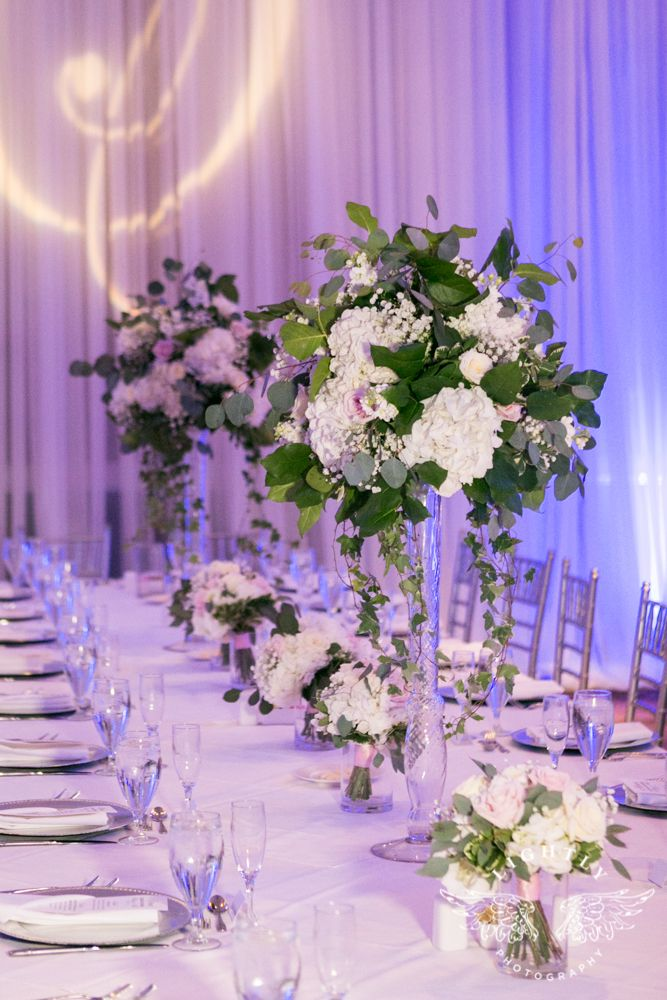 Tall Floral Centerpieces At Piazza In The Village White Flowers