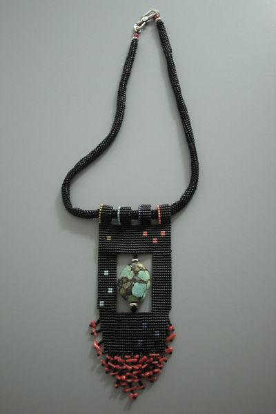 Nice bead-loomed pendant with inset focal bead, by Edda Blume