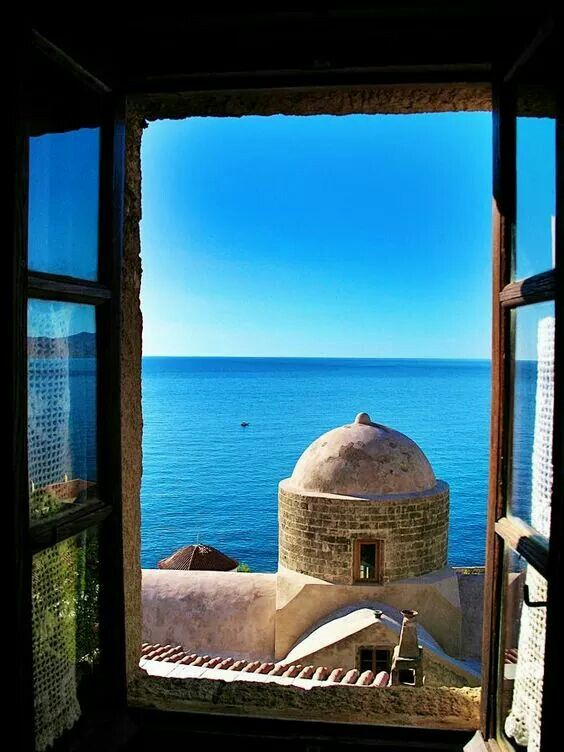 Window to blue of the sky and the sea! Monemvasia, Peloponnese, Greece