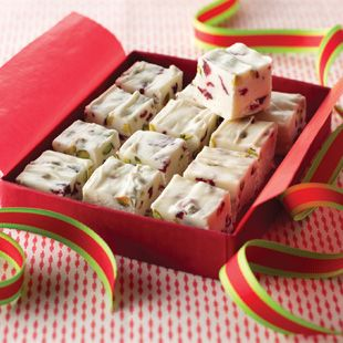 Creamy white fudge with nuggets of dried cranberries and pistachios. Wrap it in a gift box for a tasty, homemade gift!