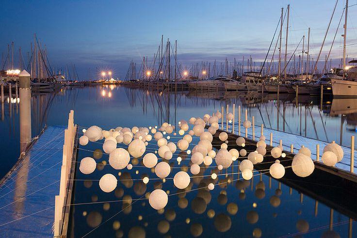 luminous lanterns form sensual wave in la grande motte, france