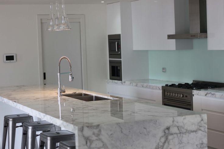 Designer white luxury kitchen in Sydney, private residence. Open plan