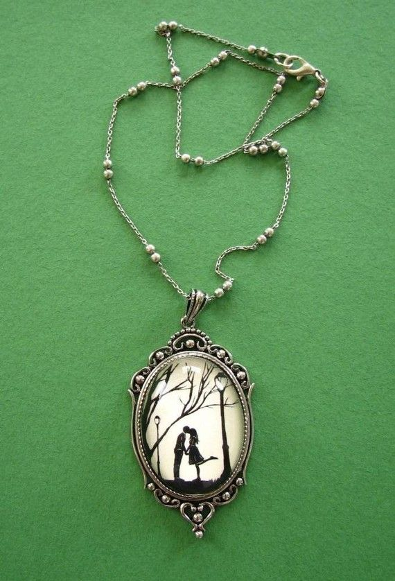 """""""Autumn Kiss Necklace, pendant on chain"""" by Tina Tarnoff of Papercut Art & Jewelry (tinatarnoff on Etsy). The Necklace was created using a print of one of my papercut images set under a clear cabochon dome, a lovely antiqued silver plated pendant base, and a delicate silver plated chain. The pendant is 2.5 inches long. The length of the chain (including the clasp) is 18 inches. Price: $50"""