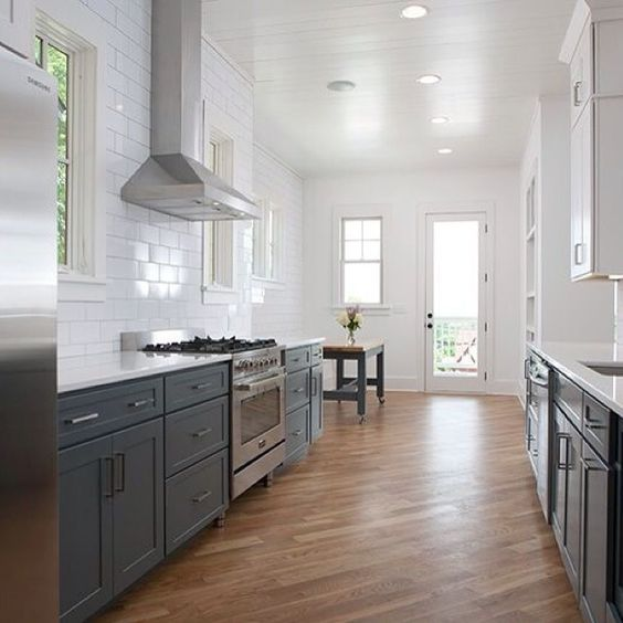 Dark grey kitchen cabinets, white subway tile and whitewashed wood ...