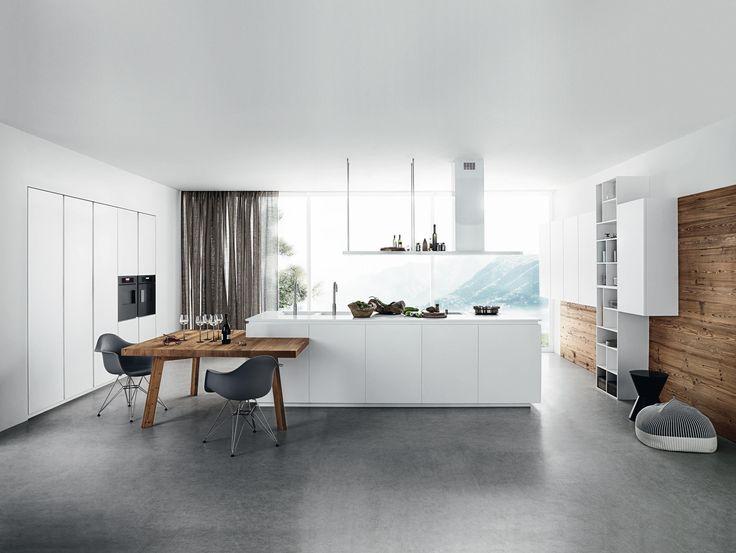 Weiß seidenmatt lackiert Tür Weiß seidenmatt lackiert, Öffnung mit Hohlkehle. Abdeckplatte aus weißem Corian, Stärke 2 cm. Tisch Lignum und..