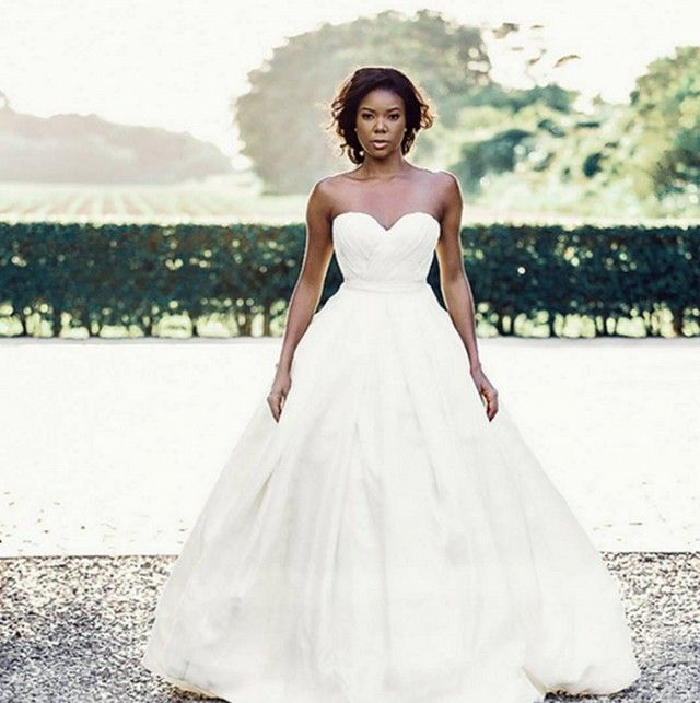 Gabrielle Union Shares Never-Before-Seen Wedding Dress Pics via @WhoWhatWear