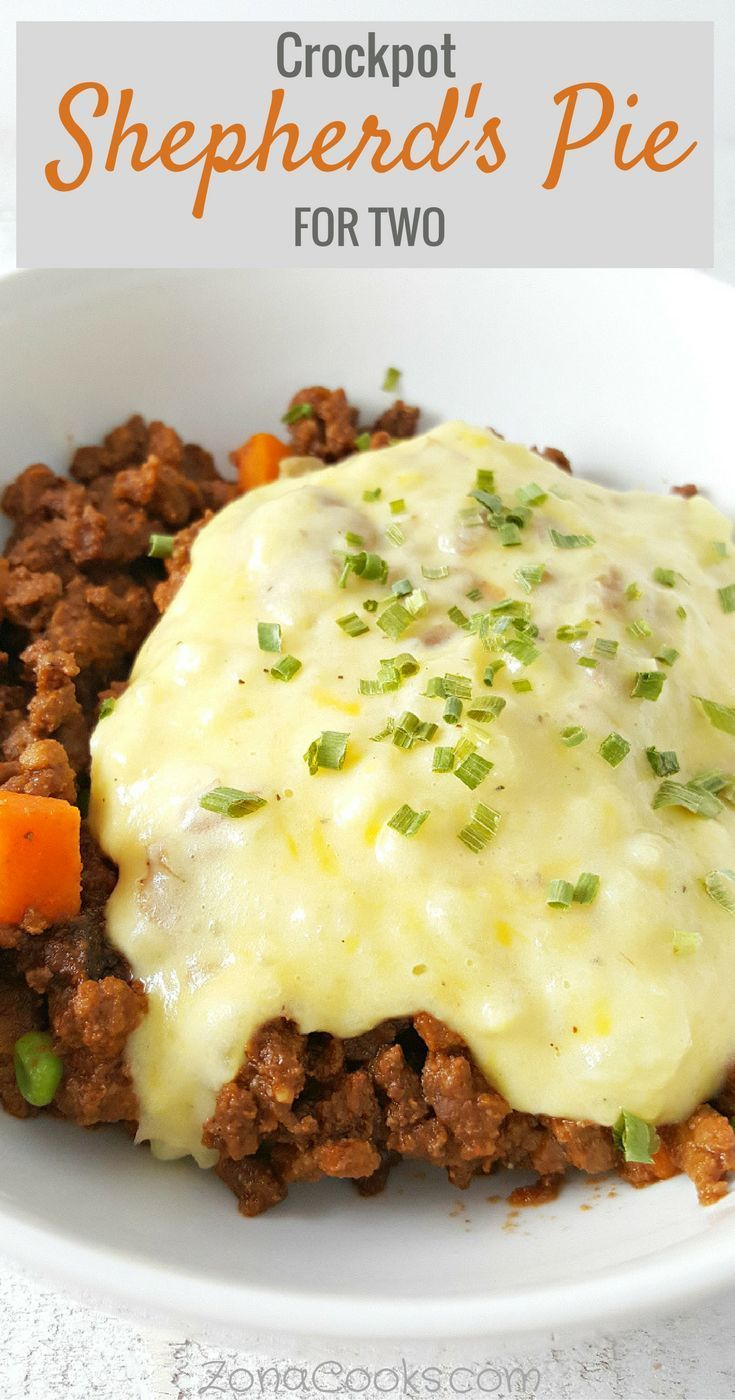 Crockpot Shepherd's Pie for Two Recipe - This Shepherd's Pie for two recipe is made in your slow cooker and is an easy way to enjoy a classic comfort food casserole. Ground beef is simmered with rich saucy mushrooms, peas and carrots topped with cheesy mashed potatoes.
