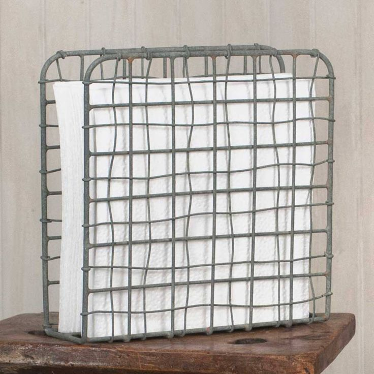 """Classic wireaccents add flair toyour country, farmhouse, primitive, or traditional decor! Primitive Wire Napkin Holder - Barn Roof Great for paper or cloth napkins Napkins are not included. 6¾""""W x 2¼""""D x 6¾""""T."""