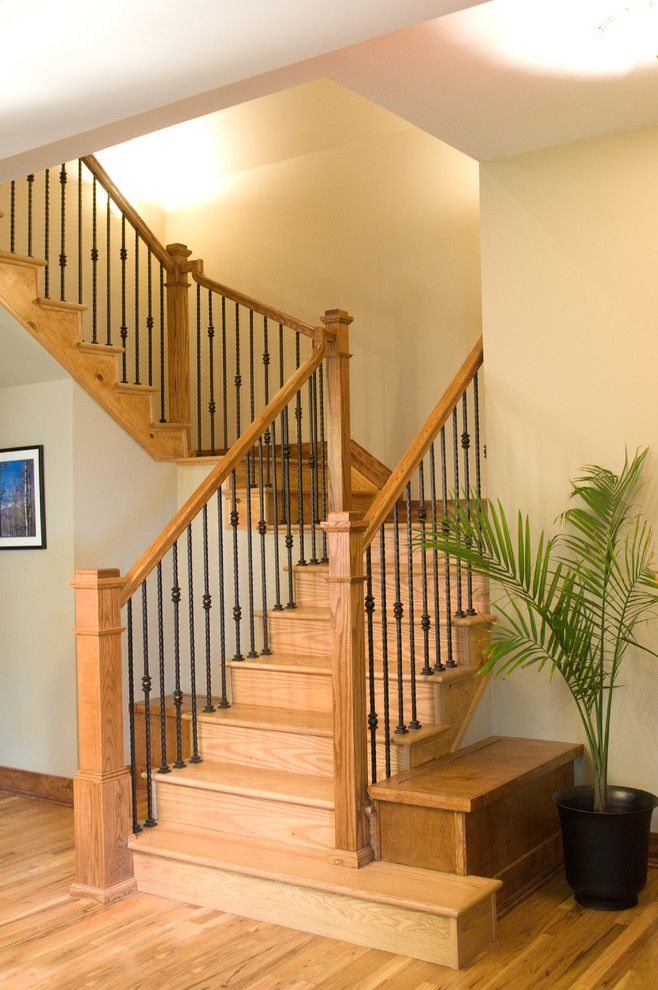 mission styled staircase made of oak and stained wrought iron rails of Mission Style Decorating, A Way to Capture Beauty and Warmth to Your Home