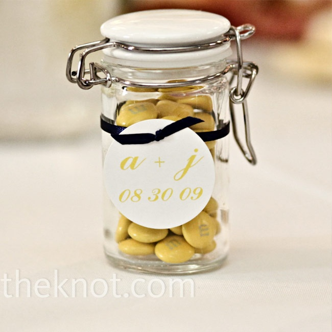 Yellow Wedding Favors- send guests home with glass jars filled with yellow M as favors. photo by: Becky Young Photography, Denver, CO