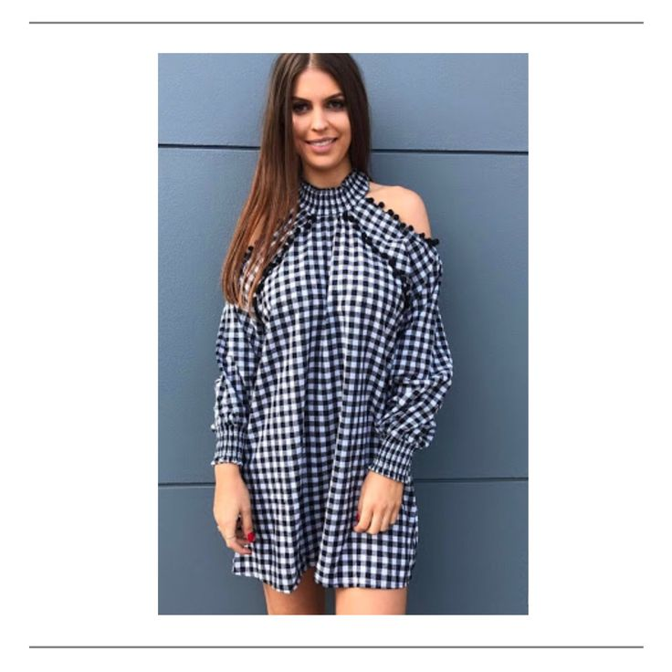 All New style now in stock and ready to ship! Pom Pom Dress in Black