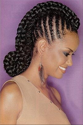 Thick braids with the Mohawk look rolled @ the nape.different.