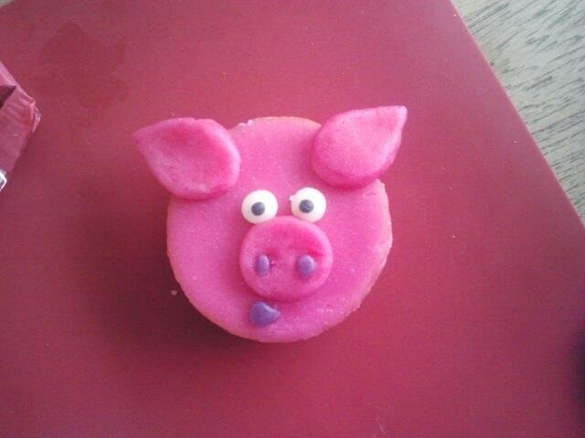 """I made this pig for my daughter who turns 3 next week.. the cup cake is a dutch """"glacé koek"""". I just added marzipan (or fondant) ears, eyes and nose. Very easy! I'm sure the children on her pre-school will love them."""