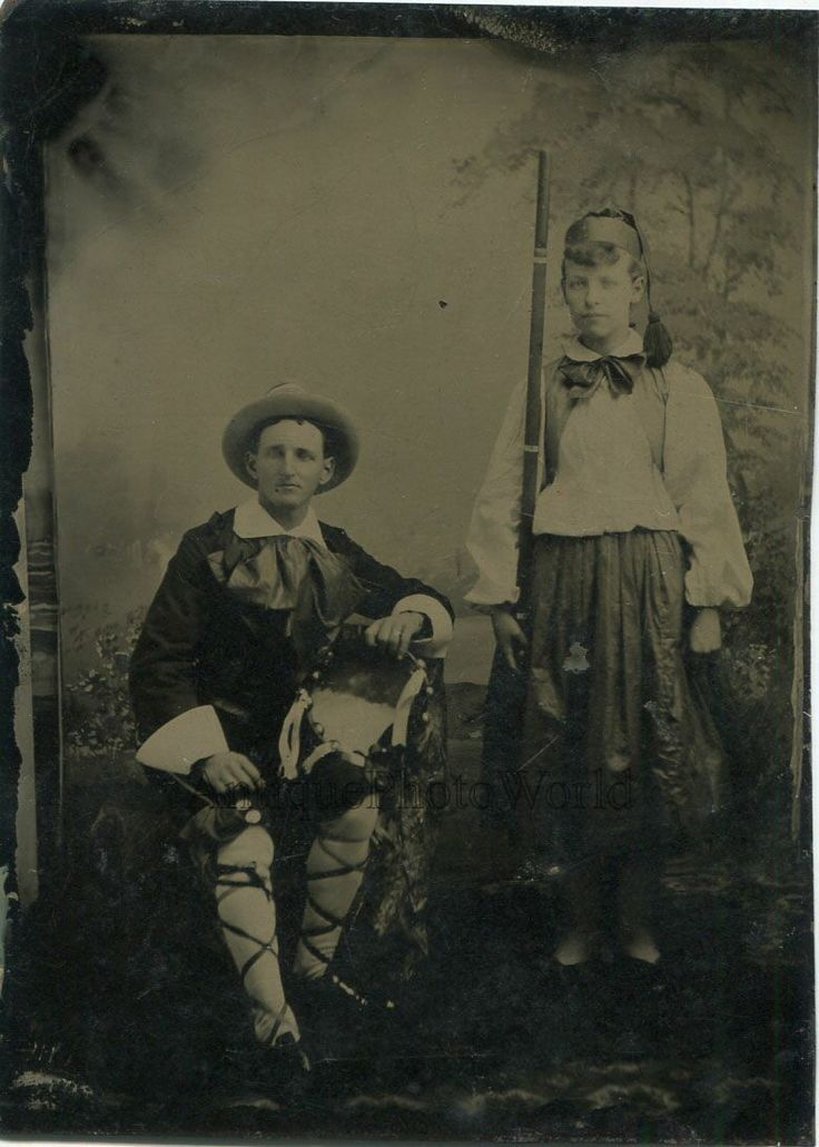 http://www.ebay.com/itm/Man-and-boy-in-amazing-costumes-w-rifle-masquerade-large-antique-tintype-photo-/272743989605?hash=item3f80cf0165:g:7MAAAOSwSzRZV6iS