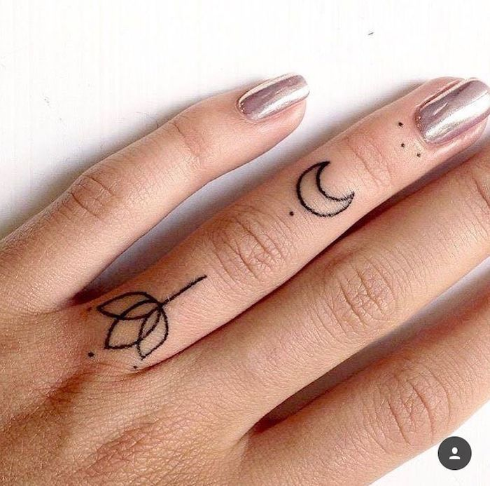 Two small tattoos on the ring finger, lotus and moon, metallic nail polish