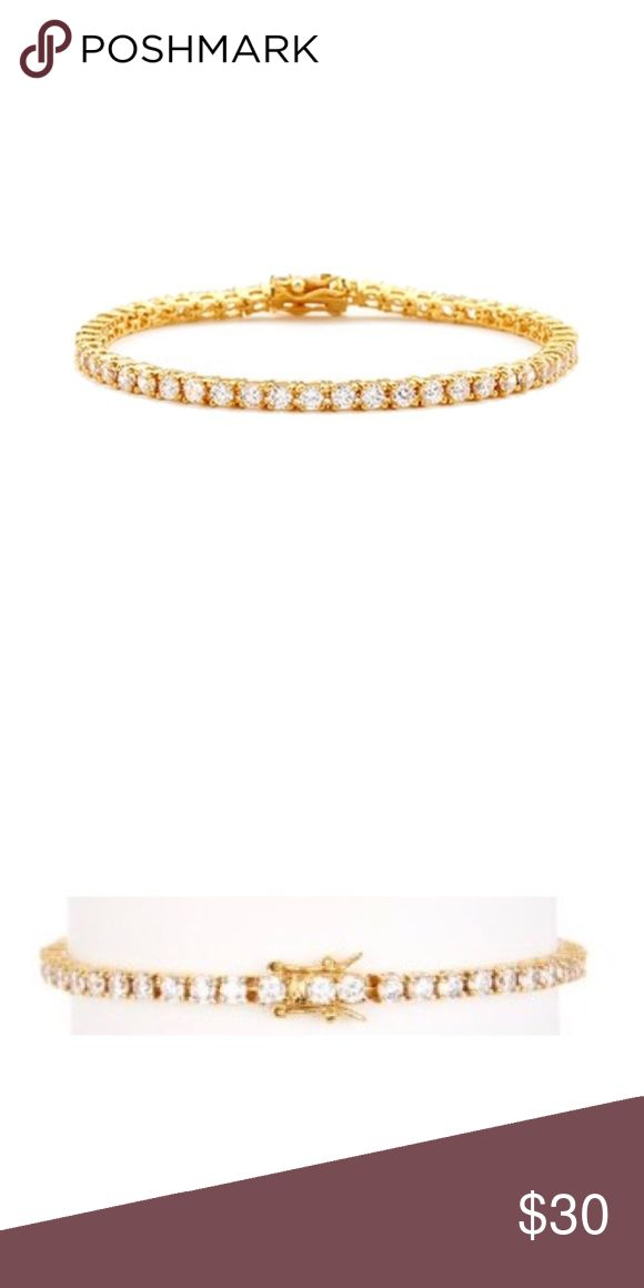 "savvy cie • tennis bracelet Details - plated white crystal tennis bracelet - Tongue and groove clasp with safety latches - Approx. 7"" L x 3mm W - Imported Materials 14K yellow gold plated, crystals Care Wipe clean with a soft, dry cloth. Savvy Cie Jewelry Bracelets"