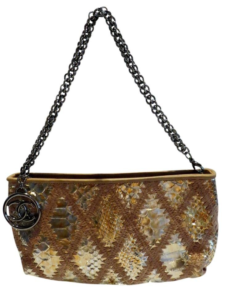 Chanel Python Gold Clutch. Get the trendiest Clutch of the season! The Chanel…
