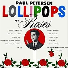 """Paul Petersen - Lollipops and Roses is the debut studio pop album by singer and actor Paul Petersen released in 1962 on Colpix Records.  Petersen began his show business career at the age of 10 as a Mouseketeer on the Mickey Mouse Club and achieved stardom playing teenager Jeff Stone from 1958 to 1966 on the ABC TV show The Donna Reed Show.  He had hit record singles with the songs """"She Can't Find Her Keys,"""" """"Amy"""" and """"Lollipops and Roses"""" and the pop song """"My Dad.""""…"""