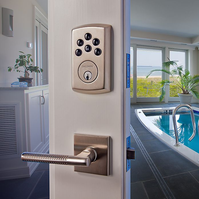 soho electronic deadbolt and the couture lever from baldwin hardware