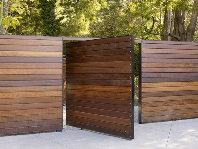 Wood Slat Fence with Metal Frame - installed at Peterson Residence by SurfaceDesign. I like the idea of an all wooden square design that is modern too.