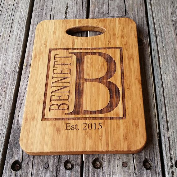 This custom-made bamboo cutting board measures 12.5 tall and 9 wide and can be engraved with the personalization of your choice. A preview of each