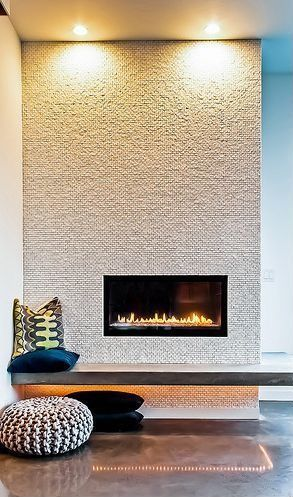 floating concrete mantle. Incredible, modern built-in gas fireplace.