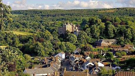 View of Dunster Castle from Conygar Tower with Dunster Village, Somerset