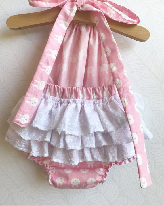 ★·.·´¯`·.·★ Bunny Baby Ruffle Romper ★·.·´¯`·.·★  The romper is halter style, with extra long straps to make a fancy bow at the back of the neck. The legs and back all have elastic for a snug fit. Three extra gathered ruffles across the bum adds an extra bit of cuteness!  Available in sizes 0-3 months - 3T  ***Shipping time is currently 1-2 weeks*** We do our absolute best to get your rompers shipped faster than that, but we cannot currently promise rompers before the expected ship ...