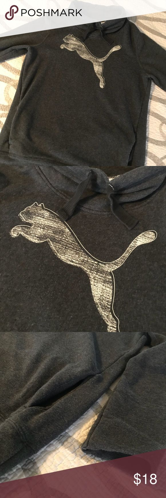 Puma Gray Funnel Neck Pullover Hoodie Puma sweatshirt. Very soft, inside feels almost like a soft terry cloth lining. Front pockets and funnel neck style. Made to fit little looser, flares out a tiny bit towards the bottom and the sleeves are little loose. No thumb holes. Gently used. Puma Tops Sweatshirts & Hoodies