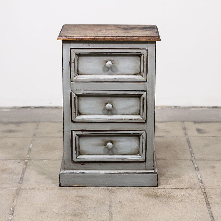 This shabby chic nightstand is featured in a solid wood with a distressed light blue gray paint finish. This rustic farmhouse end table is in great condition with 3 drawers, carved trim and a raw wood table top. Rustic bed side table perfect for a warm space! #shabbychic #dressers #nightstand #sandiegovintage #vintagefurniture
