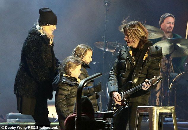 'Watching Daddy': Nicole Kidman and kids Sunday Rose, 9, and Faith Margaret, 6, bust a move at Keith Urban's New Year's Eve gig as the famous family ring in 2018