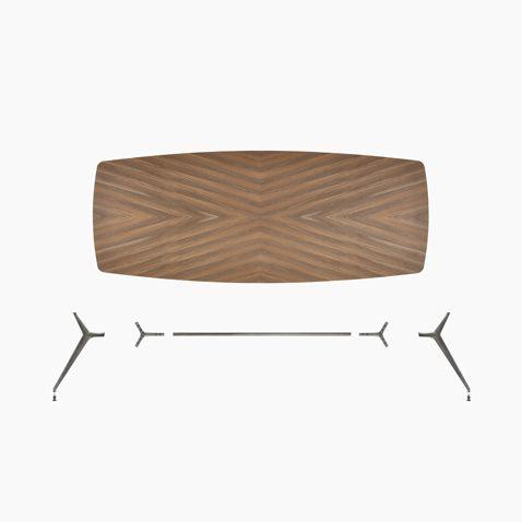 tavolo Manta nella versione boat-shaped a quattro gambe, con struttura in piombo spazzolato e piano nella finitura noce