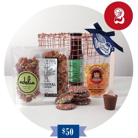 2 Turtle Doves Christmas Hamper This small Copper Basket creates a luxurious feel to this amazing selection of Australian Artisan products. Featuring Granola, Trail Mix, Cous Cous, Raspberry Sauce, Chocolates and a Hot Chocolate Spoon. The Copper Basket is a perfect keep sake and one that will be treasured.