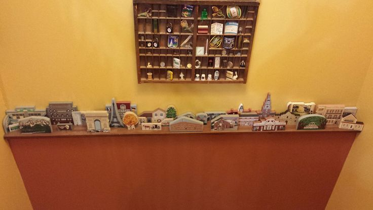 Cat's Meow collector, Deonna, finds the perfect use for the random stairway shelf. Her Cat's Meow Village grouping represents some of her favorite places.