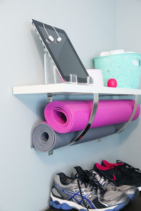 From IHeart Organizing: Exercising My Right to Organize. I love the idea of using an IKEA EKBY JÄRPEN / EKBY ROBERT wall shelf upside down in order to have a place to put yoga mats.