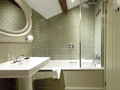 These bold, sage coloured green metro tiles show how great block colouring can be in a bathroom environment. Tiles by Solus Ceramics.