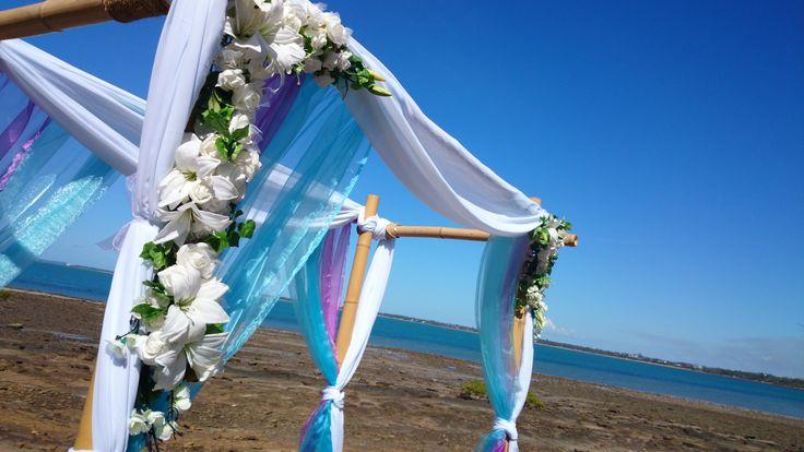 Wedding arch at a foreshore wedding with blue and purple trim. #beachwedding #starfish #wow #amazing www.astylishcelebration.com.au