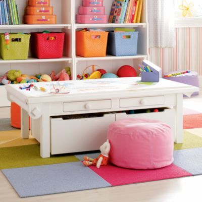 Nice functional storage for art, train set, play doh AND converts to a desk when kids are older! From Land of Nod