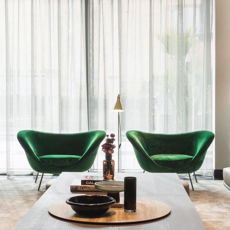 An exclusive shoot from the @HotelViuMilan lobby furnished by @MolteniDada. The iconic D.154.2 armchair design #GioPonti in the new green velvet finish perfectly blends with the sophisticated interior design. . #archiproducts #MolteniGroup #Molteni #MolteniDada