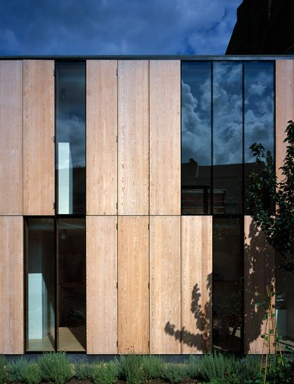 Collage House | Jonathan Tuckey Design, West Kilburn, London, UK- Hinged, larch plywood panels and glazed rear extension