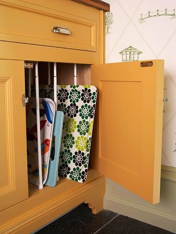 Use tension rods to organize your cookie sheets