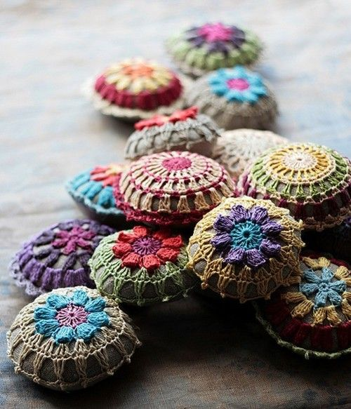 Super cute colorful crocheted stones.