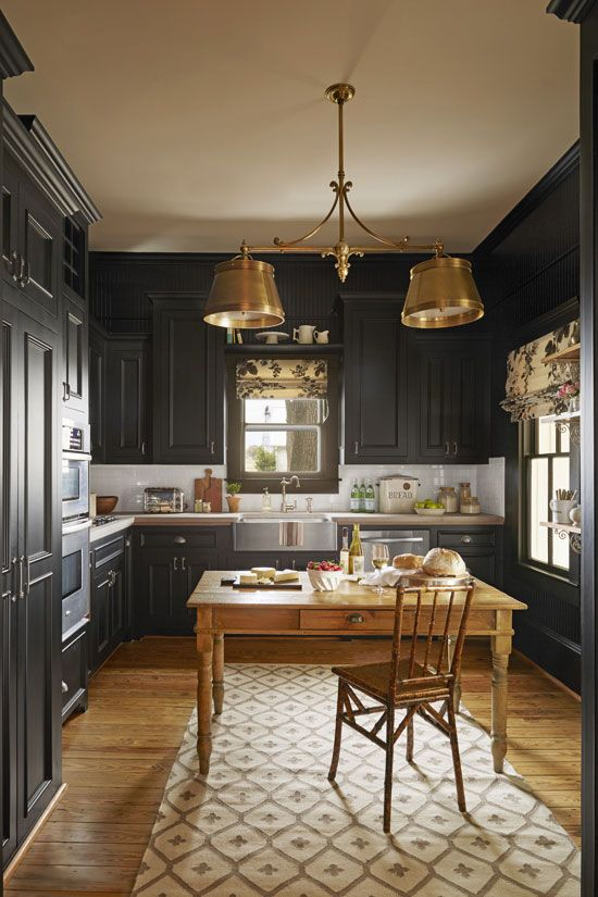 Design by Bailey McCarthy: Country Living April 2015  Farmhouse kitchen // brass // farm table // black cabinetry // butcher block // white subway tile // brass // country kitchen