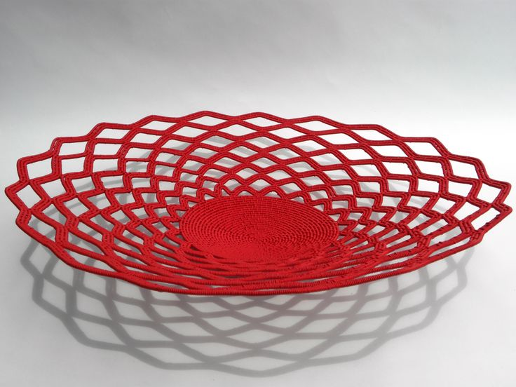 These visionary designs are achieved by collaboratively working with skilled artisans who fuse conventional African weaving techniques with contemporary telephone wire. These striking designs have been honoured in exhibitions and museums.