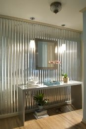 corrugated sheet metal, love love it!!! this is what I think I want for backsplash. Good contrast with frilly stuff!