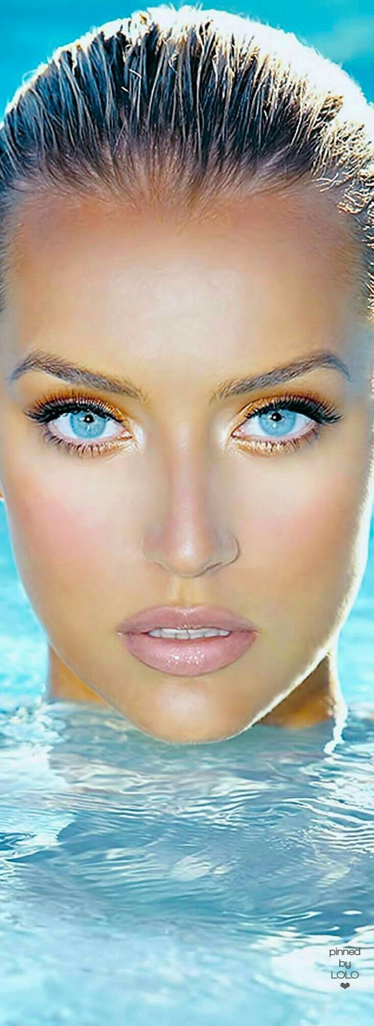 a beautiful model with piercing blue eyes. I like this models eyes truly sky blue. I don't think they r contacts or digital? beautifully looking into you the viewer. piercing you in a seemingly question or allurement.