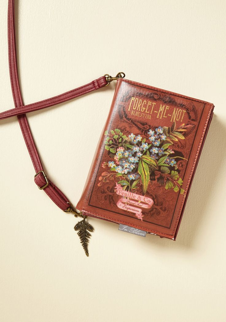 Thereby Plants a Tale Clutch. Plant a seed of whimsy with this unique, rusty red wallet by Disaster Designs. #red #modcloth