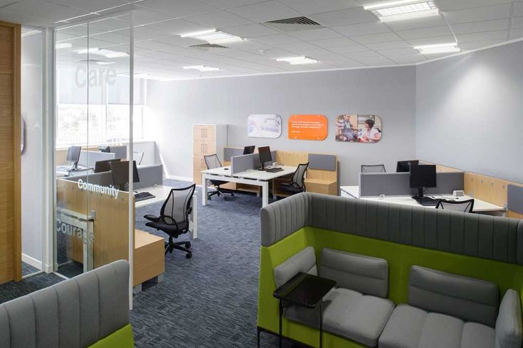 Interior Design Office with blach chairs and wooden desk also grey carpet