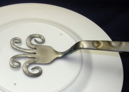 Bent for backing a plate flower. The handle goes into a pipe  or conduit.