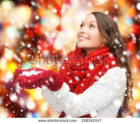 winter, people, happiness concept - woman in scarf and gloves with big snowflake - stock photo